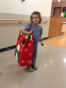 Christmas gifts from UT athletes - this bag is nearly as big as she is!